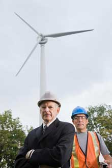 men with wind turbine